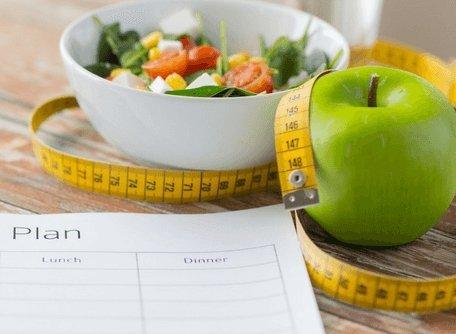 healthy food, salad and apple